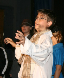 Boy performing as Charlie