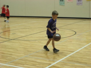 boy dribbling ball